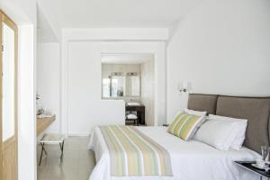 A bed or beds in a room at DeLight Boutique Hotel Small Luxury Hotels of the World