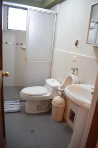 Un baño de Villas House