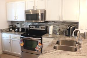 A kitchen or kitchenette at Luxury 3 Bedroom Villa Resort - Private Hot Tub