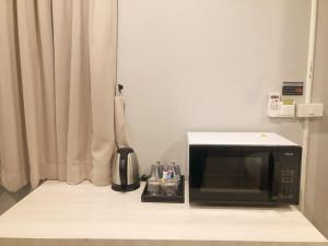 A television and/or entertainment centre at GN Luxury Hostel