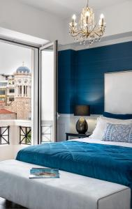 A bed or beds in a room at Evripidou Suites