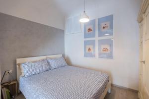 Cama o camas de una habitación en Piazza del Mercato Centrale