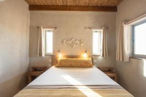 A bed or beds in a room at Nof Zuqim