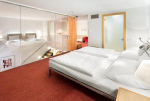 A bed or beds in a room at Vienna House Andel´s Prague