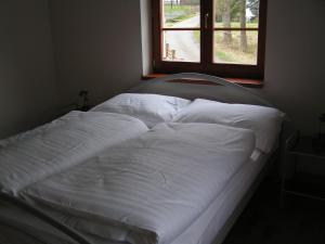A bed or beds in a room at Holiday Villa Merklin