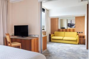 A television and/or entertainment center at Four Points by Sheraton Padova