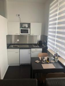 Küche/Küchenzeile in der Unterkunft Business Appartements