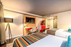 A bed or beds in a room at Century Park Hotel LA