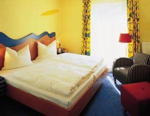 Кровать или кровати в номере Hotel am Kurpark