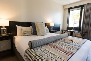 A bed or beds in a room at The Matador