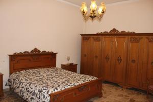 Letto o letti in una camera di Appartamento stanze Ragusa