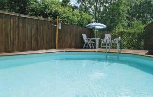 The swimming pool at or near Holiday Home La Blotiere