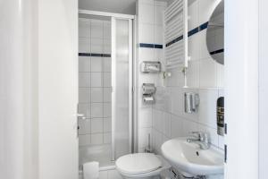 A bathroom at a&o Prague Metro Strizkov