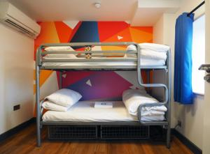A bunk bed or bunk beds in a room at St Christopher's Inn Village - London Bridge