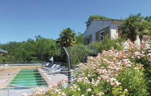 A view of the pool at Four-Bedroom Holiday Home in Malataverne or nearby