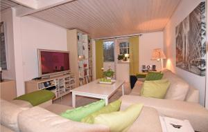 A seating area at Holiday Home Henån with a Fireplace 04