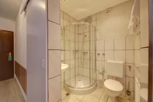 Ein Badezimmer in der Unterkunft Hotel Deutschmeister