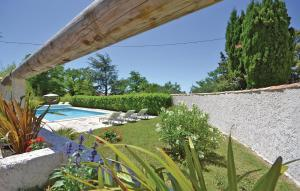 The swimming pool at or near One-Bedroom Holiday Home in Bollene