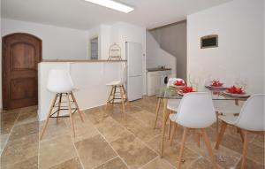 A kitchen or kitchenette at One-Bedroom Holiday Home in Bollene