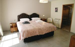 A bed or beds in a room at Eight-Bedroom Holiday Home in Saint Dizier Leyrenne