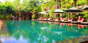 The swimming pool at or near La Niche D'angkor Boutique Hotel