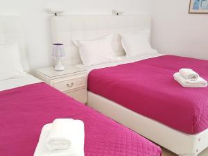 Ένα ή περισσότερα κρεβάτια σε δωμάτιο στο Πανσιόν Πτολεμαίος