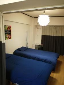 A bed or beds in a room at CPM Center of Shinjuku6