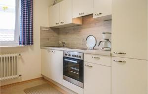 Küche/Küchenzeile in der Unterkunft Holiday Home Alpirsbach - 08