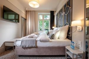 A bed or beds in a room at Amber Design Residence