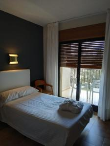 A bed or beds in a room at Balneario de Ledesma