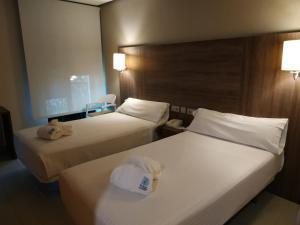 A bed or beds in a room at Balneario de Ledesma