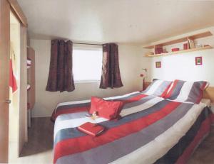 A bed or beds in a room at Camping de l'Abbatiale