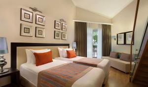 Een bed of bedden in een kamer bij Akka Alinda Hotel