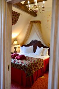 Кровать или кровати в номере Grand Rose SPA Hotel