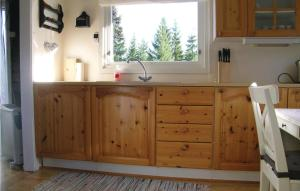 A kitchen or kitchenette at One-Bedroom Holiday Home in Fannrem