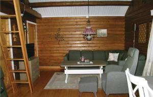 A seating area at One-Bedroom Holiday Home in Fannrem