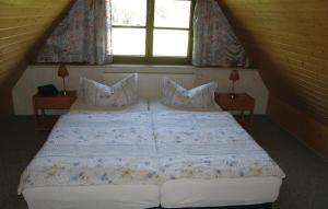 Ein Bett oder Betten in einem Zimmer der Unterkunft Ferienhaus Waldstr. R