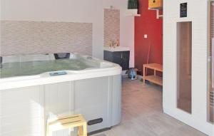 A bathroom at Holiday Home Narbonne with a Hot tub 05