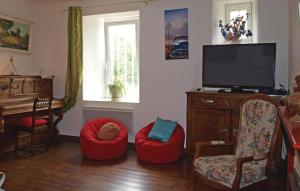 A seating area at Awesome home in Treguier with WiFi and 5 Bedrooms