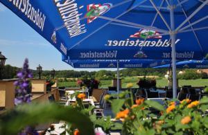 Ein Restaurant oder anderes Speiselokal in der Unterkunft Landgasthof - Café Anni