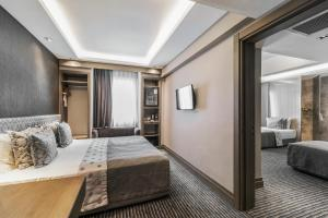 A bed or beds in a room at Grand Beyazit Hotel