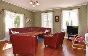 En sittgrupp på Six-Bedroom Holiday Home in Hogsater