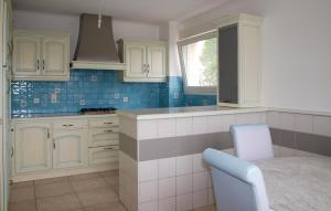 A kitchen or kitchenette at Holiday Home Pledran with Fireplace I