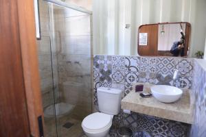 Um banheiro em Pousada Charme e Estilo