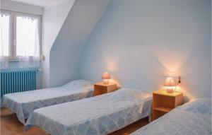 A bed or beds in a room at Holiday Home Pledran with Fireplace I