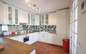 A kitchen or kitchenette at Holiday Home Les Issambres with Sea View II