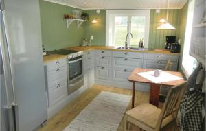 A kitchen or kitchenette at Two-Bedroom Holiday Home in Odeshog