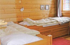 A bed or beds in a room at Holiday home Ottsjö Mossvägen Undersåker