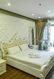 A bed or beds in a room at Tredi 18 Residence