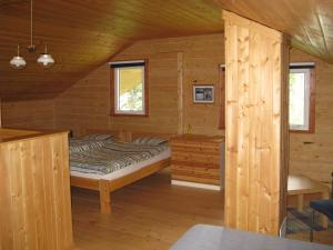 A bed or beds in a room at Little Atlin Lodge
